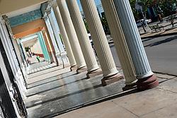 Sidewalk by the Paseo del Prado in the UNESCO world heritage city of Cienfuegos, Cuba.