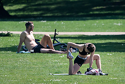 © Licensed to London News Pictures. 09/05/2020. London, UK. People exercise and sunbathe in St James's Park, central London during lockdown. The government is set to announce measures to ease lockdown, which was introduced to fight the spread of the COVID-19 strain of coronavirus. Photo credit: Ben Cawthra/LNP
