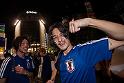 Soccer fans celebrate the Japan National Team qualifying for the next round of the 2018 World Cup in Russia. Japan lost to Poland  0-1 but managed to move to the next stage on points. Thousands of younger fans gathered at Tokyo's iconic Shibuya crossing to enjoy the moment with police controlling the crowds