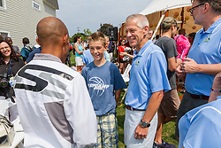 Beach to Beacon 10K press day: Larry Wold and young runner meets Meb Keflezighi