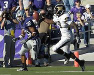 MANHATTAN, KS - NOVEMBER 17:  Wide receiver Jeremy Maclin #9 of the Missouri Tigers reaches for a bobbled pass in the third quarter as free safety Chris Carney #30 of the Kansas State Wildcats defends on the play on November 17, 2007 at Bill Snyder Stadium in Manhattan, Kansas.  Missouri won the game 49-32.  (Photo by Peter Aiken/Getty Images)