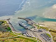Nederland, Noord-Holland, Texel 07-05-2021; het Horntje, de haven van Den Hoorn, met de veerboot Dokter Wagemaker van rederij TESO. Auto's staan opgesteld om met het veer mee te kunnen.<br /> Het Horntje, the harbor of Den Hoorn, with the ferry Dokter Wagemaker from shipping company TESO. Cars are lined up to go with the ferry.<br /> aerial photo (additional fee required)<br /> copyright © 2021 foto/photo Siebe Swart