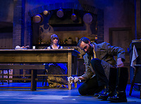 """Miss Julie played by Rebecca Tucker sits in the kitchen while her valet Jean played by Nicholas Wilder shines a pair of boots during dress rehearsal for """"Miss Julie"""" at the Winnipesaukee Playhouse on Tuesday evening.  (Karen Bobotas/for the Laconia Daily Sun)"""
