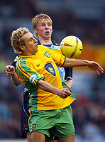 Photo: Scott Heavey.<br />Coventry v Norwich. Nationwide Division One. 14/02/2004.<br />Darren Huckerby holds the ball up from Calum Davenport