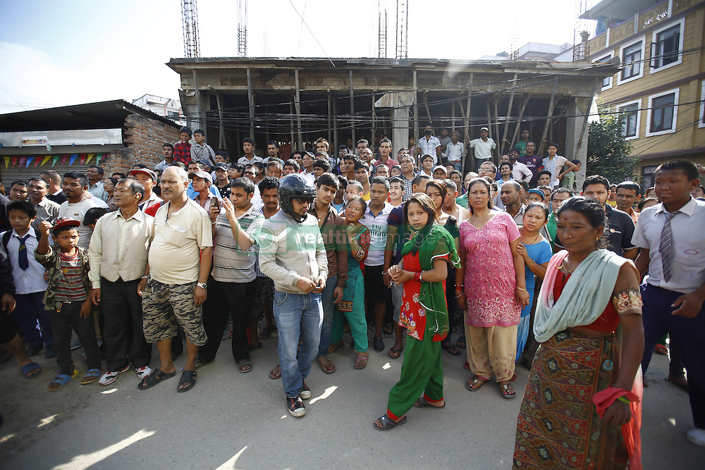 September 20, 2016 - Kathmandu, Nepal - Nepalese people gather to watch at the site where the bomb was placed at Kanchanjunga School in Dallu, Kathmandu, Nepal on Tuesday, September 20, 2016. Improvised explosive devices were placed in 7 schools as 2 bombs exploded. No human casualties have been reported in the explosions. (Credit Image: © Skanda Gautam via ZUMA Wire)