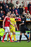 Swindons Michael Smith receives a yellow card during the Sky Bet League 1 match between Swindon Town and Milton Keynes Dons at the County Ground, Swindon, England on 4 April 2015. Photo by Shane Healey.