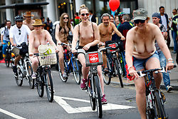 © Licensed to London News Pictures. 13/06/2015. London, UK. Nude protesters touring in Westminster, London on Saturday, 13 June 2015 as part of the World Naked Bike Ride event, which protests against car culture and aims to raise awareness of cyclists on the roads. Photo credit: Tolga Akmen/LNP