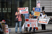 Supporters of Wikileaks founder Julian Assange protest outside London's Old Bailey court as his fight against extradition to the US has resumed, on 16th September 2020, in London, England. Assange has been in Belmarsh Prison for 16 months and is wanted over the publication of classified documents in 2010 and 2011. If convicted in the US, he faces a possible penalty of 175 years in jail.