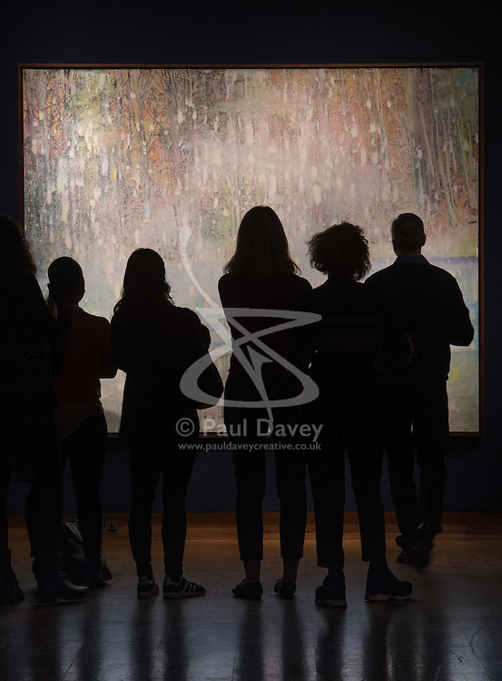Christie's, London, March 3rd 2017. PICTURED: Gallery visitors admire Peter Doig's 'Cobourg 3 + 1 More' which is expected to fetch between £8-12 million.  Fine art auctioneers Christies hold a press preview for their Post-War and Contemporary Art auctions to be held on March 7th and 8th.