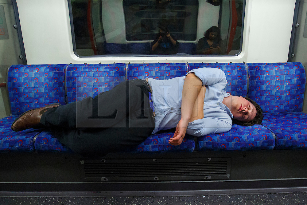 © Licensed to London News Pictures. 20/08/2016. London, UK. A tube passengers sleeps whilst travelling on the night tube service of Central line in London for the first time on 20 August 2016. Transport for London started a 24-hour Tube service on Victoria and Central lines as demand has soared over recent years, with passenger numbers on Friday and Saturday nights up by around 70 per cent since 2000. The plan was announced in November 2013 and intended to begin in September 2015, but strikes over pay delayed the start by nearly another year. Photo credit: Tolga Akmen/LNP
