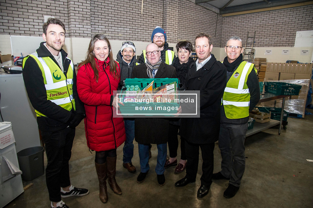 Pictured: Aileen Campbell, Kevin Stewart, Elena Whitham and Jon Sparkes were joined by volunteers (some up from London) at the depot.<br /> <br /> Today, Communities Secretary Aileen Campbell was joined by Councillor Elena Whitham, Cosla Community Wellbeing Spokesperson, Kevin Stewart, Minister for Local Government, Housing and Planning and Jon Sparkes Chief Executive of Crisis as she visited Cyrenians' Good Food depot where she met staff at the depot and toured the facility which redistributes surplus food to not-for-profit organisations. <br /> <br /> Ger Harley   EEm 27 November 2018