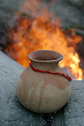 The clay Kumbha (water pot) has a special significance in the Hindu cremation ritual. It is blessed in the early stages of the ritual and then, most often during the series of rituals designed to ensure the proper path in death for a loved one, the Kumbha is carried by a mourner three times around the burning body then dropped (and it breaks).