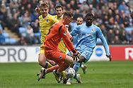 Bristol Rovers goalkeeper (on loan from Brentford) Jack Bonham (13) gets to the ball in front of Coventry City striker Amadou Bakayoko (21) during the EFL Sky Bet League 1 match between Coventry City and Bristol Rovers at the Ricoh Arena, Coventry, England on 7 April 2019.