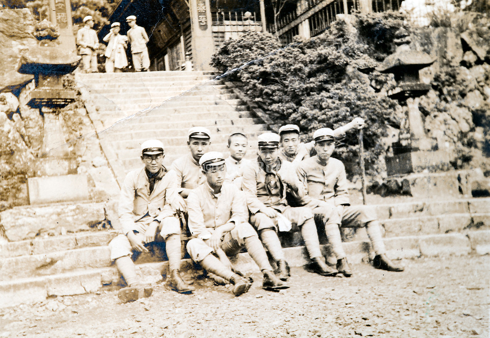 group of tired students on a sighteeing trip Japan ca 1940s