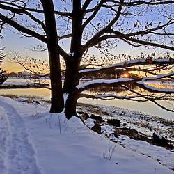 The Goose Island Trail at sunrise  in Portsmouth, New Hampshire.  Society for the Protection of New Hampshire Forests' Creek Farm Reservation.  Sagamore Creek. Winter. Tidal Creek.