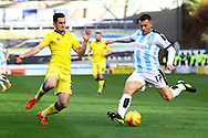 Lewis Cook of Leeds united looks to tackle Harry Bunn of Huddersfield Town (r). Skybet football league Championship match, Huddersfield Town v Leeds United at the John Smith's Stadium in Huddersfield, Yorks on Saturday 7th November 2015.<br /> pic by Chris Stading, Andrew Orchard sports photography.
