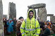Dr Larch Maxey joins over one hundred people, including local residents, climate and land justice activists and pagans, at a Mass Trespass at Stonehenge on 5th December 2020 in Salisbury, United Kingdom. The trespass was organised in protest against the approval by Transport Secretary Grant Shapps of a £1.7bn project for a two-mile tunnel beneath the World Heritage Site and a further eight miles of dual carriageway for the A303, as well as the government's £27bn Road Investment Strategy 2 (RIS2).