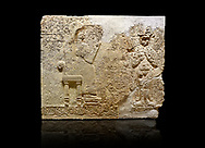 """Hittite relief sculpted orthostat stone panel  of Long Wall Limestone, Karkamıs, (Kargamıs), Carchemish (Karkemish), 900-700 BC. Anatolian Civilisations Museum.<br /> <br />  The hieroglyphics reads; """"I am Win-a-tis, beloved wife of my Lord Suhi, wherever and whenever my husband honours his name, he will honour my name as well with favours"""". Underneath, there are two goddess figures, one is naked with a horned head, holding her breasts with her hands. Her genitalia is indicated by a triangle. <br /> <br /> On a black background. .<br />  <br /> If you prefer to buy from our ALAMY STOCK LIBRARY page at https://www.alamy.com/portfolio/paul-williams-funkystock/hittite-art-antiquities.html  - Type  Karkamıs in LOWER SEARCH WITHIN GALLERY box. Refine search by adding background colour, place, museum etc.<br /> <br /> Visit our HITTITE PHOTO COLLECTIONS for more photos to download or buy as wall art prints https://funkystock.photoshelter.com/gallery-collection/The-Hittites-Art-Artefacts-Antiquities-Historic-Sites-Pictures-Images-of/C0000NUBSMhSc3Oo"""