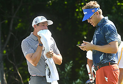 July 13, 2018 - Silvis, Illinois, U.S. - SILVIS, IL - JULY 13:  Scott Stallings and Ricky Barnes take a break before teeing off on the #2 hole during the second round of the John Deere Classic on July 13, 2018, at TPC Deere Run, Silvis, IL.  (Photo by Keith Gillett/Icon Sportswire) (Credit Image: © Keith Gillett/Icon SMI via ZUMA Press)