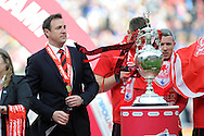 Cardiff city manager Malky Mackay keeps an eye on the championship  trophy.  NPower championship, Cardiff city v Bolton Wanderers at the Cardiff city Stadium in Cardiff, South Wales on Saturday 27th April 2013. pic by Andrew Orchard,  Andrew Orchard sports photography,
