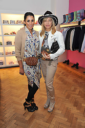 Left to right, SERENA REES and MAIA NORMAN at a party to launch a range of SpongeBob SquarePants suits and accessories designed by Richard James in partnership with Nickelodeon held at Richard James, 29 Savile Row, London W1 on 11th May 2011.