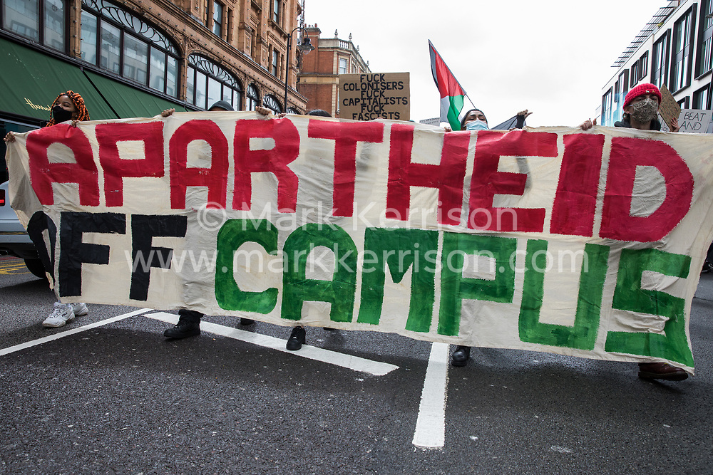 Protesters walk behind an Apartheid Off Campus banner during a Free Palestine SOS Colombia march in solidarity with the Palestinian and Colombian peoples from the Colombian embassy to the Israeli embassy on 15th May 2021 in London, United Kingdom. Speakers at a rally before the march, which took place on Nakba Day, highlighted human rights abuses being directed against Palestinians in Israel and the Occupied Territories, in particular attempts at forced displacements in Sheikh Jarrah in East Jerusalem, and also in Colombia, where peaceful demonstrators and human rights defenders have been killed and subjected to repression, detention and torture.