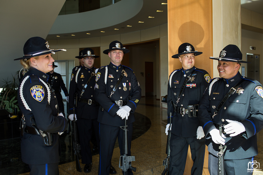 Members of the Milpitas Police Department Honor Guard wait in the hallway before performing the 21-Gun Salute during the City of Milpitas Memorial Day ceremony at Milpitas City Hall in Milpitas, California, on May 30, 2016. (Stan Olszewski/SOSKIphoto)