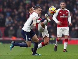 Arsenal's Alexis Sanchez (left) and Tottenham Hotspur's Kieran Trippier battle for the ball during the Premier League match at the Emirates Stadium, London.