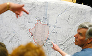 Residents evacuated from the Yarnell Hill fire point at a map of the burned area at a community meeting in Prescott, Arizona July 2, 2013.   An elite squad of 19 Arizona firemen was  killed in the worst U.S. wildland firefighting tragedy in 80 years apparently outflanked and engulfed by wind-whipped flames in seconds, before some could scramble into cocoon-like personal shelters on June 30, 2013.  REUTERS/Rick Wilking (UNITED STATES)