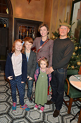 CAMILLA RUTHERFORD and DOMINIC BURNS with her children, HECTOR, MAUD & NANCY at a party hosted by Camila Batmanghelidjh for Kids Company held at The Ivy Market Grill, 1 Henrietta Street, Covent Garden, London on 23rd November 2014.