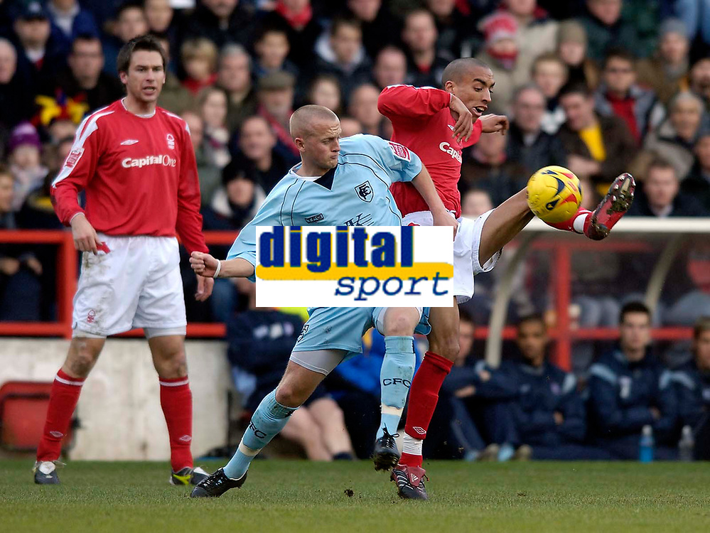 Photo: Jed Wee.<br />Nottingham Forest v Chesterfield. Coca Cola League 1.<br />31/12/2005.<br />Forest's Nathan Tyson (R) tries to control the ball as Chesterfield's Sammy Clingan exerts some pressure.