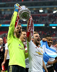 David De Gea and Juan Mata of Manchester United celebrate winning the FA Cup with the Trophy - Mandatory by-line: Robbie Stephenson/JMP - 21/05/2016 - FOOTBALL - Wembley Stadium - London, England - Crystal Palace v Manchester United - The Emirates FA Cup Final