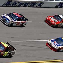 April 17, 2011; Talladega, AL, USA; NASCAR Sprint Cup Series driver Jeff Gordon (24) leads Dale Earnhardt Jr. (88), Mark Martin (5) and Landon Cassill (09) during the Aarons 499 at Talladega Superspeedway.   Mandatory Credit: Derick E. Hingle