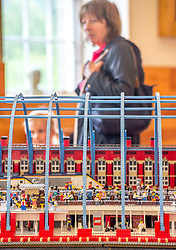 Some of the first visitors walk past one of the exhibition pieces all made entirely from Lego bricks, which goes on display to the public at the New Lanark World Heritage Village from today. <br /> <br /> © Dave Johnston/ EEm