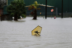 August 26, 2017 - Rockport, Texas, USA - A toppled school crossing sign is partially submerged in flood water in the aftermath of Hurricane Harvey in Rockport, Texas on Saturday, Aug. 26, 2017. (Credit Image: © San Antonio Express-News via ZUMA Wire)