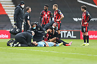 Football - 2020 / 2021 Sky Bet Championship - AFC Bournemouth vs. Coventry City - The Vitality Stadium<br /> <br /> Josh Pask of Coventry has his neck supported by a medical team member as Bournemouth's Philip Billing  sits up after the two players clashed heads during the Championship match at the Vitality Stadium (Dean Court) Bournemouth <br /> <br /> COLORSPORT/SHAUN BOGGUST