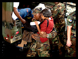 30th August, 2005. Aftermath of Hurricane Katrina, New Orleans, Louisiana. An elderly woman is carried to safety as she arrives at the Superdome.