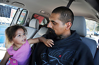 Adalasia and Ricardo chill out in the van. Ricardo works the night shift, and gets little sleep.