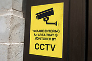 Warning sign offers information that CCTV cameras are operating in the area in London, United Kingdom.