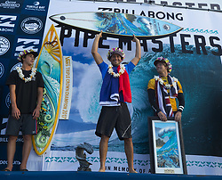December 18, 2017 - Banzai Pipeline, HI, USA - BANZAI PIPELINE, HI - DECEMBER 18, 2017 - From left, Vans Triple Crown of Surfing champion Griffin Colapinto, Billabong Pipe Masters champion Jeremy Flores of France, and World Surf League world champion John John Florence of Hawaii. (Credit Image: © Erich Schlegel via ZUMA Wire)
