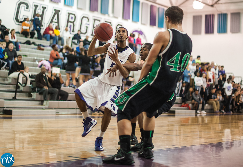 Cox Mill's Malik Johnson looks to shoot against West Stanly Friday night at Cox Mill High School. The Chargers won the game 62-44.