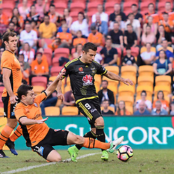 BRISBANE, AUSTRALIA - APRIL 16: Kosta Barbarouses of the Phoenix is tackled by Tommy Oar of the Roar during the round 27 Hyundai A-League match between the Brisbane Roar and Wellington Phoenix at Suncorp Stadium on April 16, 2017 in Brisbane, Australia. (Photo by Patrick Kearney/Brisbane Roar)