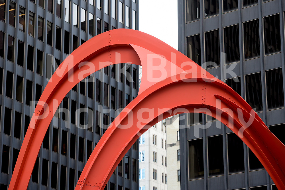 The Everett McKinley Dirksen and John C. Kluczynski building and Flamingo sculpture by Alexander Calder in Chicago, Illinois's Federal Plaza. Photo by Mark Black