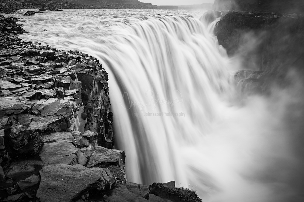 """Dettifoss is a waterfall in Vatnajökull National Park in Northeast Iceland, and is reputed to be the most powerful waterfall in Europe. The water comes from the nearby Vatnajökull glacier, whose sediment-rich runoff colors the water a greyish white. The superlative of """"most powerful"""" comes from its water flow times its fall distance. The water of the wide Jökulsá á Fjöllum river falls for more than 44 metres, causing a massive, crashing spray."""