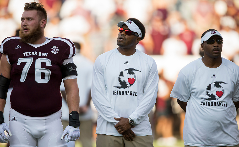 """Texas A&M head coach Kevin Sumlin, center, sings along to """"the Spirit of Aggieland"""" before the start of an NCAA college football game against Nicholls State Saturday, Sept. 9, 2017, in College Station, Texas. Texas A&M won 24-14. (AP Photo/Sam Craft)"""