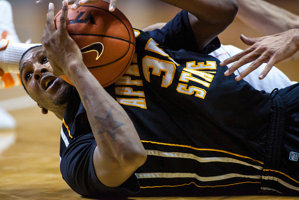 Nov 23, 2012; Blacksburg, VA, USA; Appalachian State Mountaineers forward Jay Canty (35) grabs a loose ball on the floor against the Virginia Tech Hokies during the first half at Cassell Coliseum. Mandatory Credit: Peter Casey-US PRESSWIRE