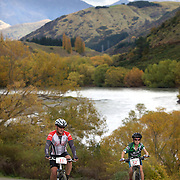 Mark Smith (left) and Hamish McHugh-Smith in action during the New World Tour de Wakatipu bike race on Saturday. Six hundred and ninety people entered the bike race which featured an  exclusive course with breathtaking views from Millbrook Resort in Arrowtown to Chard Farm along the Kawarau River, via the trails and tracks of the Wakatipu basin with distances of 36 kilometres fun riding for recreational bikers and 45 kilometres for elite and sport racers. The event was part of the inaugural Queenstown Bike Festival, which took place from 16th-25th April. The event hopes to highlight Queenstown's growing profile as one of the three leading biking centres in the world. Queenstown, Central Otago, New Zealand. 23rd April 2011. Photo Tim Clayton..