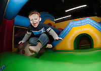 """Gavin Dunnam takes a giant jump during the first annual """"Jump a Thon"""" on Sunday at Jump 'n Joy to benefit the 2012 WLNH Children's Auction.  (Karen Bobotas/for the Laconia Daily Sun)"""