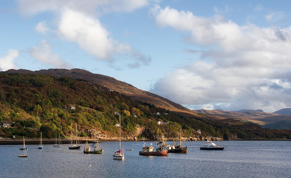 Ullapool is a remote, but rather larger town. It serves as a significant ferry terminal for destinations in the Hebrides. In WWII is was where the Mirmansk convoys were assembled. There is nothing warlike in the soft evening light splashing on the adjacent hills.