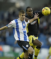 Photo: Aidan Ellis.<br /> Sheffield Wednesday v Birmingham City. Coca Cola Championship. 16/12/2006.<br /> Sheffield's Tommy Spurr battles with Birmingham's Cameron Jerome